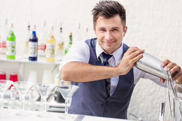 barman pouring a cocktail drink
