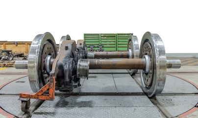 Spare railway wheels on the axle in a repair workshop on isolate