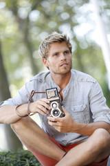 Trendy photographer using vintage camera