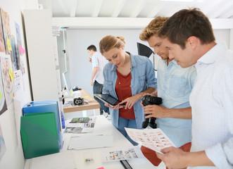Creative team meeting in photographer's studio
