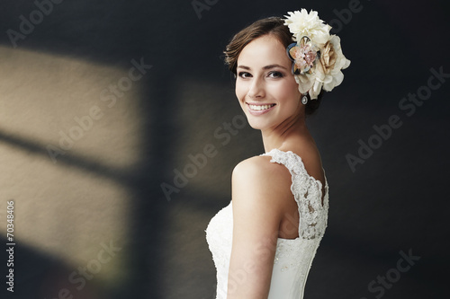 canvas print picture Glamorous young bride in wedding dress, smiling.