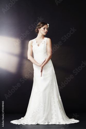 canvas print picture Glamorous bride in wedding dress, looking away.