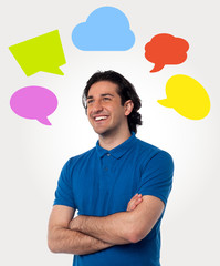 Confident young man with speech bubbles