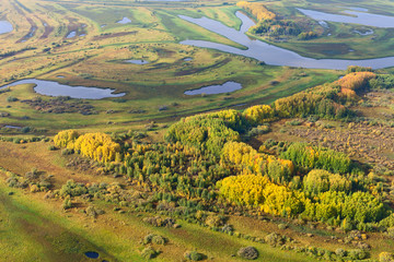 Terrain with river in autumn, top view