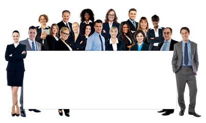 Diverse business people holding a banner