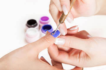 Nail gel salon.Applying nail art.