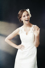 Gorgeous young bride showing wedding ring.