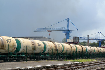Cargo structure with oil products at railway station
