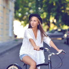Pretty girl on bicycle