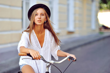 Seductive young woman on a vintage bike