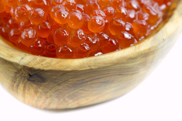 Red caviar in a wooden bowl