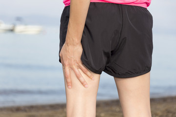 Woman with injured leg muscles during workout