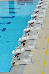 Row Of Starting Blocks At A Swimming Pool
