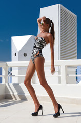 Sexy fashion woman with long legs in swimsuit, in shoes