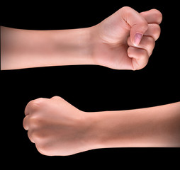 Powerful fist pump against black background
