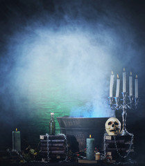 Halloween background with a lot of different witchcraft tools:
