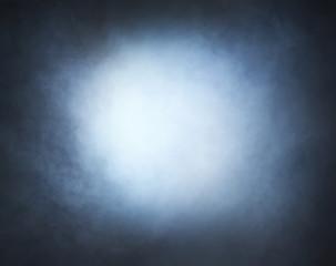 Light blue smoke over black background