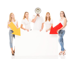 Group of teenagers holding arrrows on a blank, white billboard