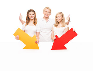 Group of teenagers holding arrows with a blank, white billboard