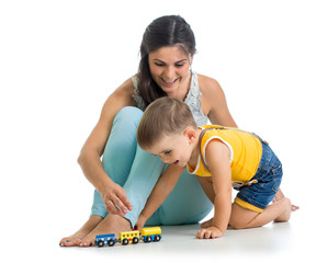 child boy and his mother play with toy