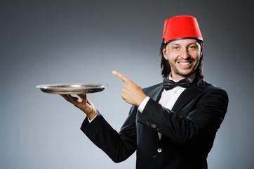 Waiter wearing traditional turkish hat