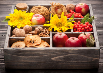 Autumn Collage in wooden box. Apples, nuts, flowers sunflower