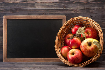 Red apples and board with space for text