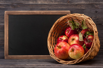 Red apples in basket with space for text