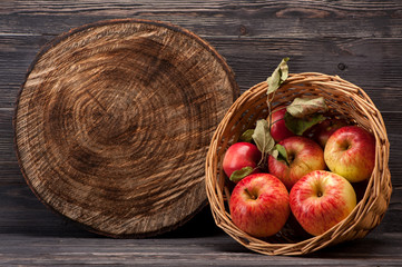 Red apples and textured wooden board with space for text