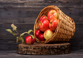 Red apples in old basket