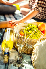 Two glasses, white wine and grapes, picnic theme