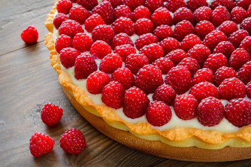 Delicious raspberry tarts on a wooden board