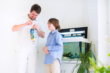 Father and son with a new fish pet