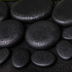 spa concept of zen basalt stones with dew, closeup