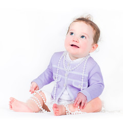 Little girl with a pearl necklace