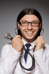 Young doctor with stethoscope in medical concept
