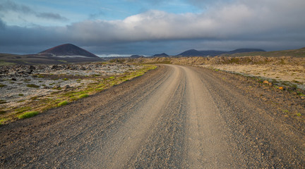 Wide angle view of track through Iceland, cloudy sky
