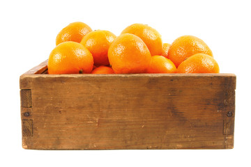 Tangerines in an old box