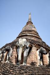 Elephant statue around pagoda at Wat Chang Lom temple , Sukhotha