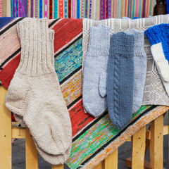 wool socks and mittens hanging on rustic cloth