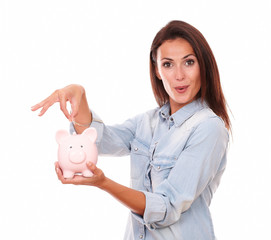 Lovely charming woman with her piggybank