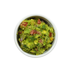 Bowl of Guacamole dip and nachos isolated on white background