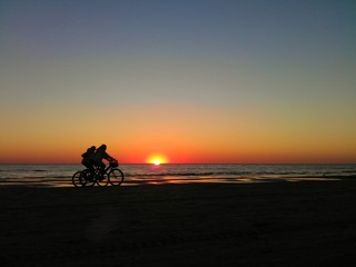 Ridding bikes at sunset