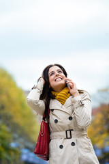 Happy woman on cellphone call outside