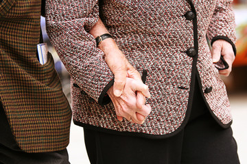 Old hand in hand closeup