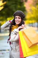 Woman with shopping bags in autumn