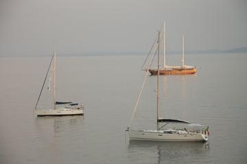 Three yachts near with coast of Corfu, Greece
