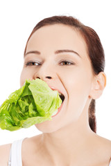 Smiling woman eating salat