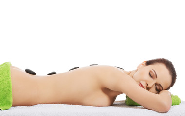 Girl on a stone therapy, hot stone massage