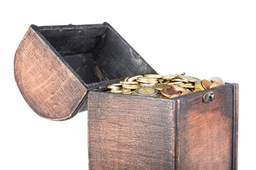 Wooden money chest filled with coins